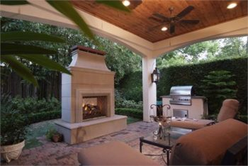 Wood Covered Patio With Custom Outdoor Fireplace
