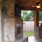 Custom Houston Covered Patio With A Stone Fireplace